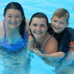 Swimming at overnight youth summer camp in Illinois